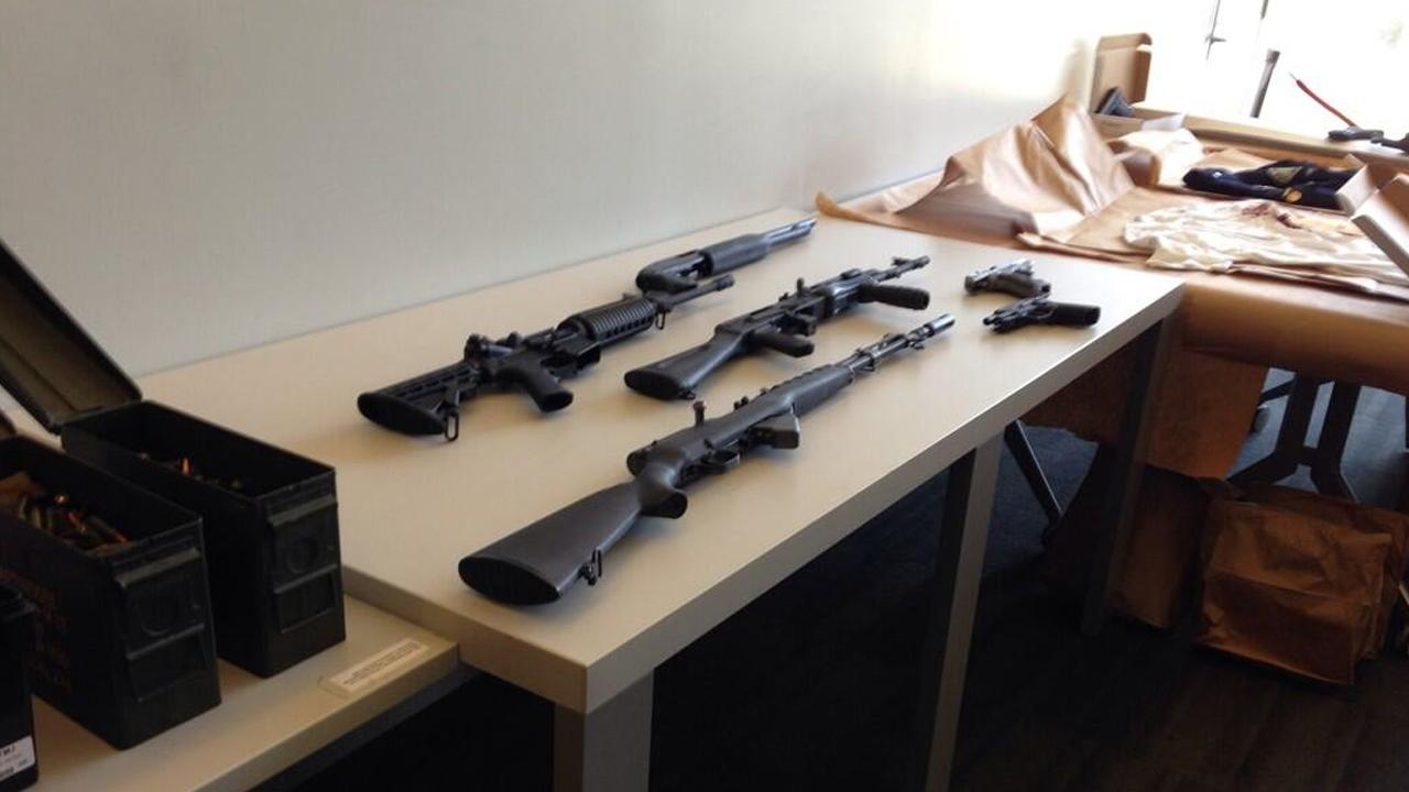 Weapons were seized at the home of the gunman who opened fire on LAPD officers at a police station in Mid-City.