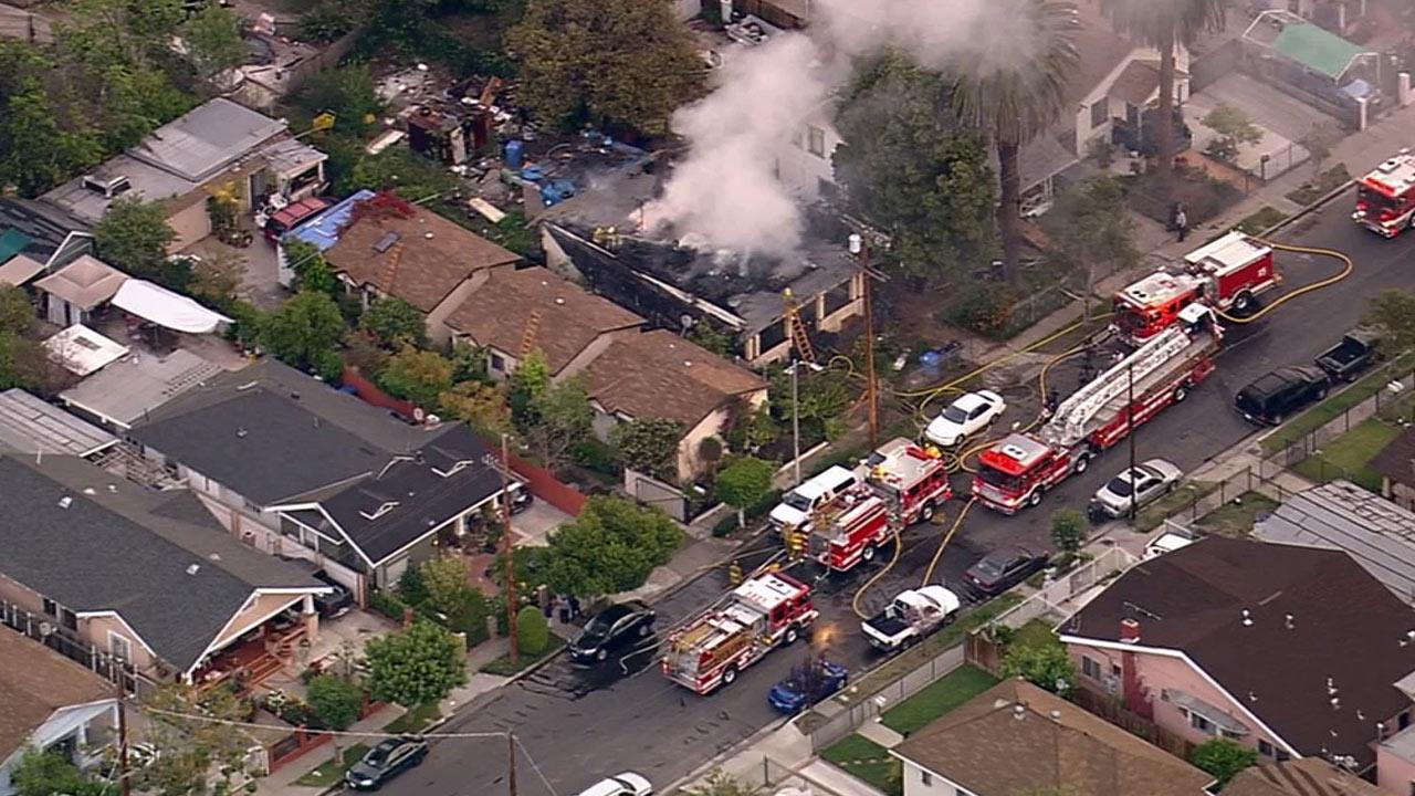 A fire erupted at a house in Los Angeles Jefferson Park area on Wednesday, April 9, 2014.