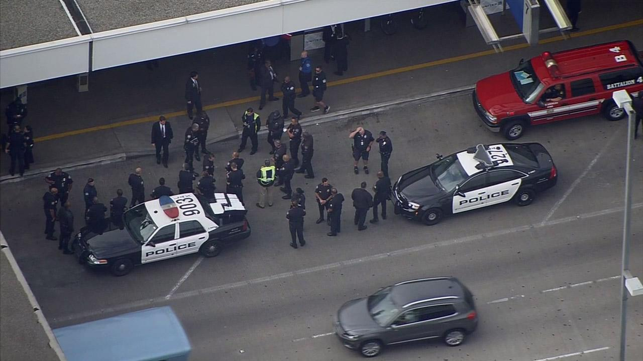 Police investigate following a bomb threat at Los Angeles International Airport on Thursday, April 17, 2014.