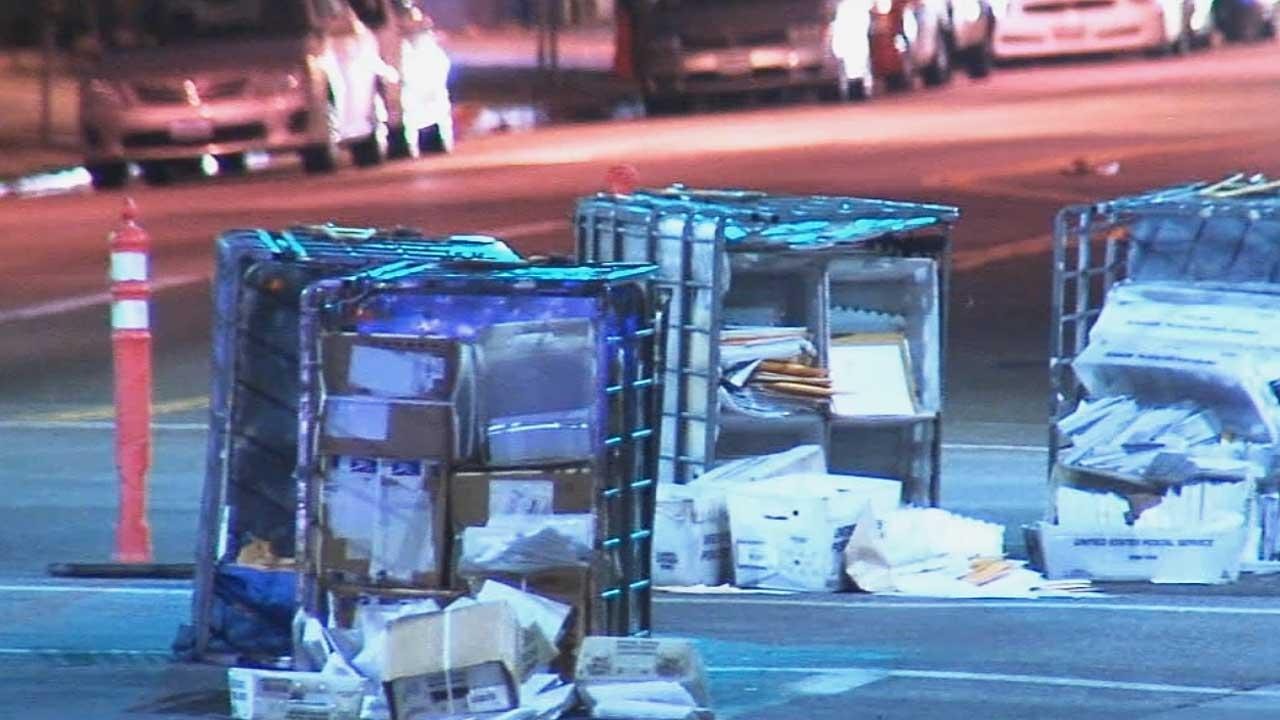 Dozens of crates of mail were found on a Hollywood street Friday, April 18, 2014.