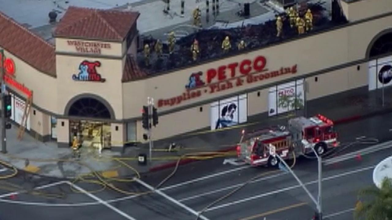 Crews battle a fire at a Petco in Westchester on Wednesday, April 30, 2014.