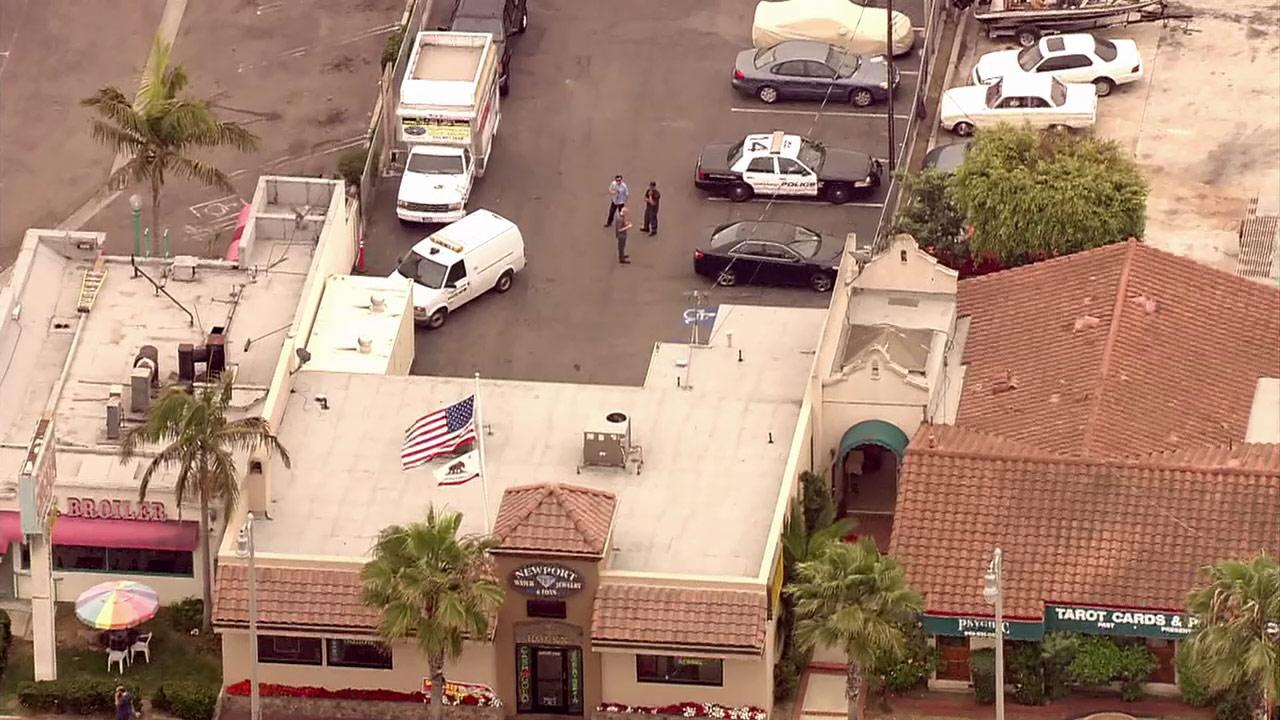 Costa Mesa police are searching for four gunmen who held up a jewelry store in a violent robbery Monday.