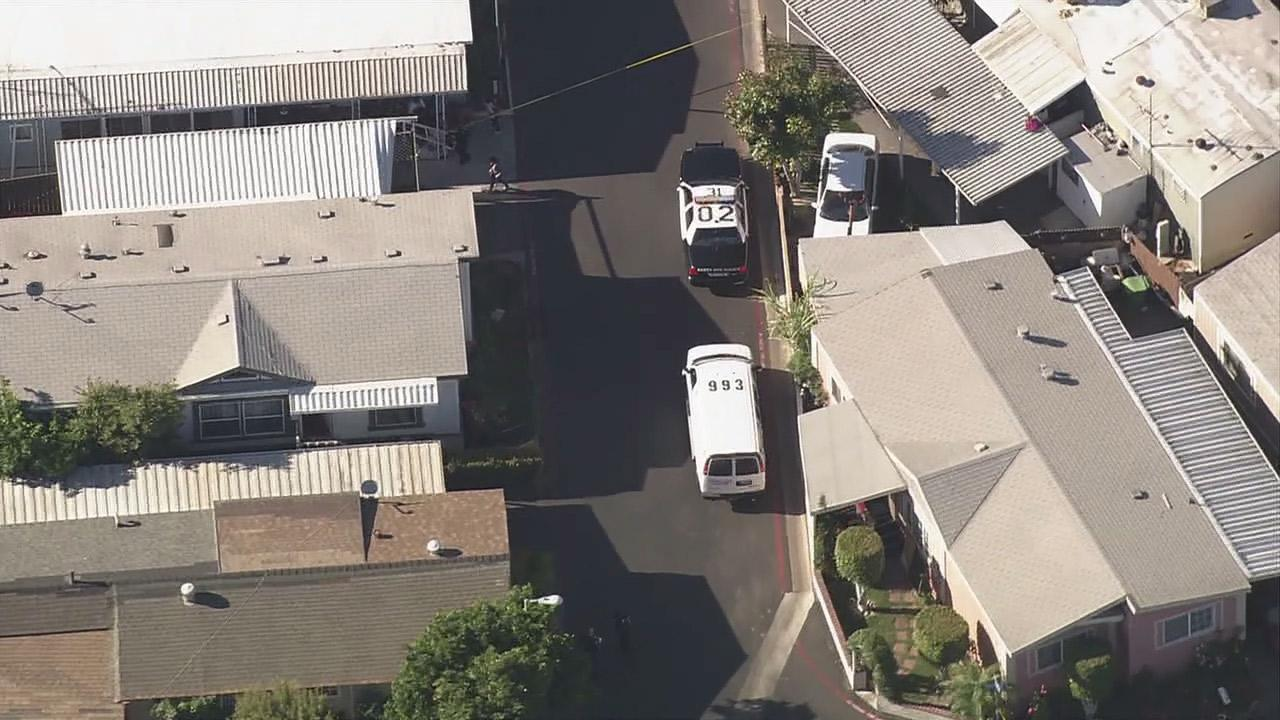 Authorities are seen at a Santa Ana mobile home park where a 2-month-old baby girl was found dead in a bathtub Friday, June 29, 2012.