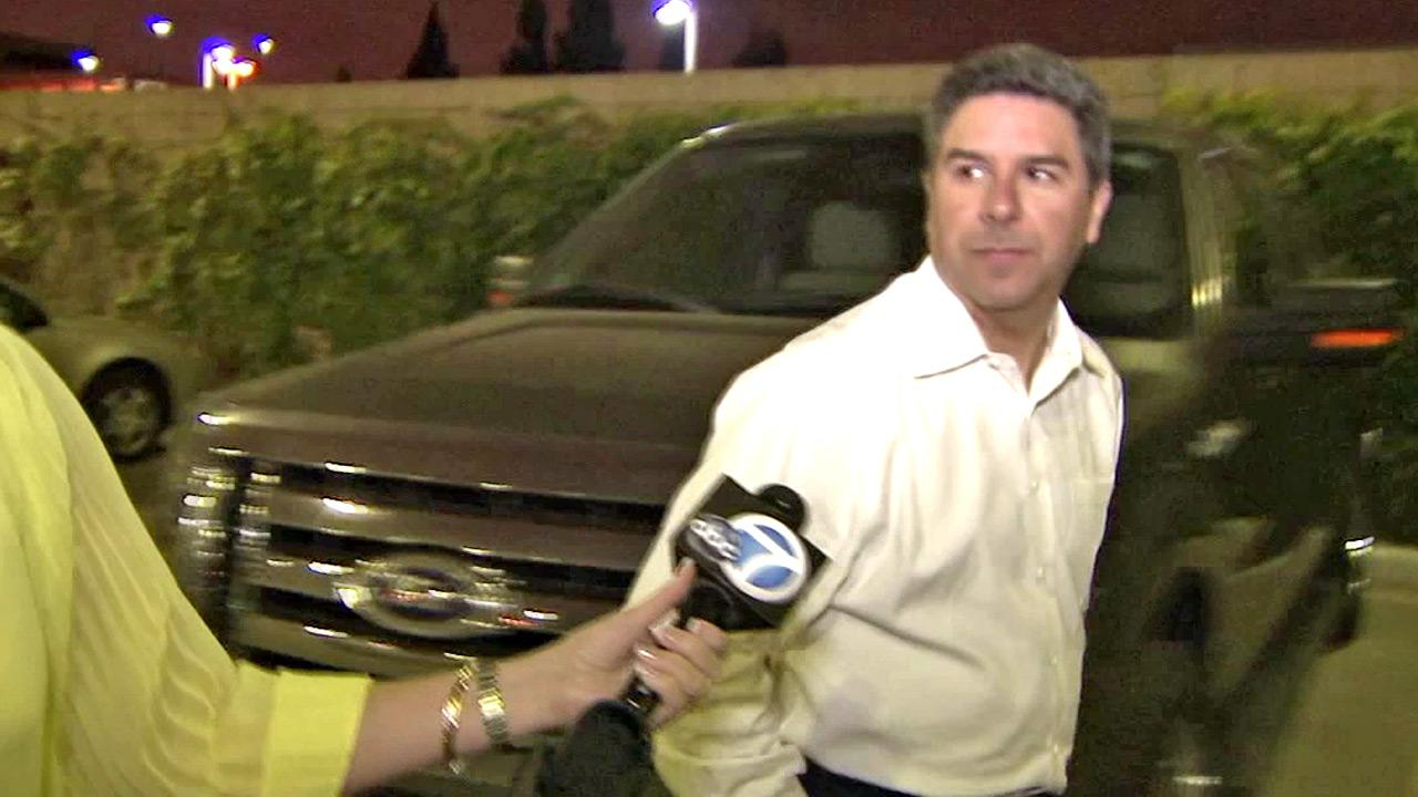Santa Ana City Councilman Carlos Bustamante exits the Orange County Jail on bond on Monday, July 2, 2012, after being booked on several charges, including sexual battery, assault, stalking and false imprisonment.