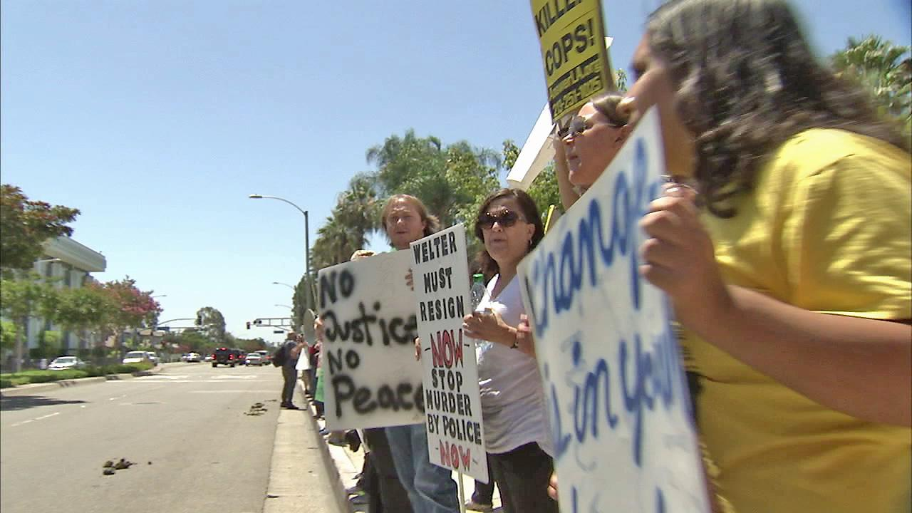 Demonstrators protesting deadly officer-involved shootings in July 2012 are seen in this undated file photo.