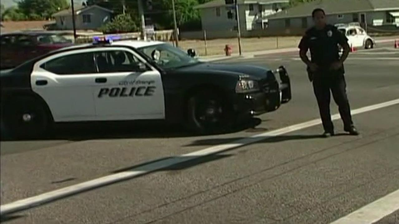 A patrol car is parked at the scene of a hit-and-run in Orange on Wednesday, Sept. 19, 2012.