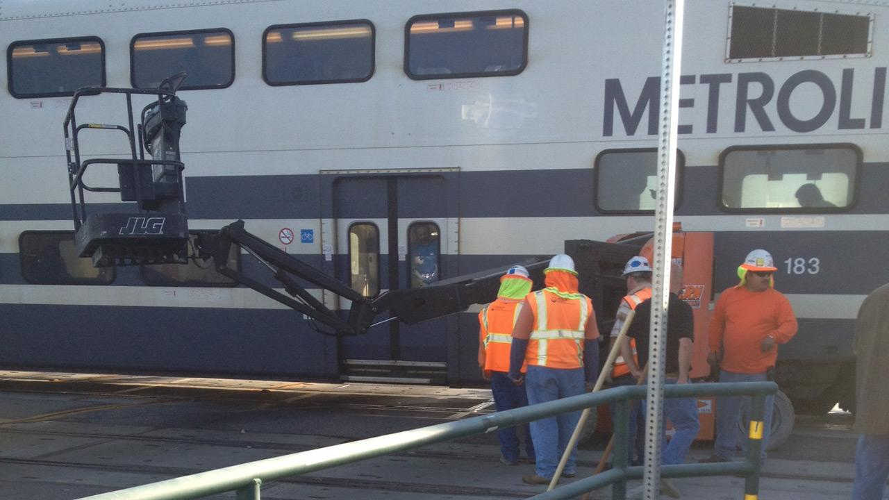 A crane fell over and blocked a Metrolink train in Santa Ana on Tuesday, Oct. 2, 2012.