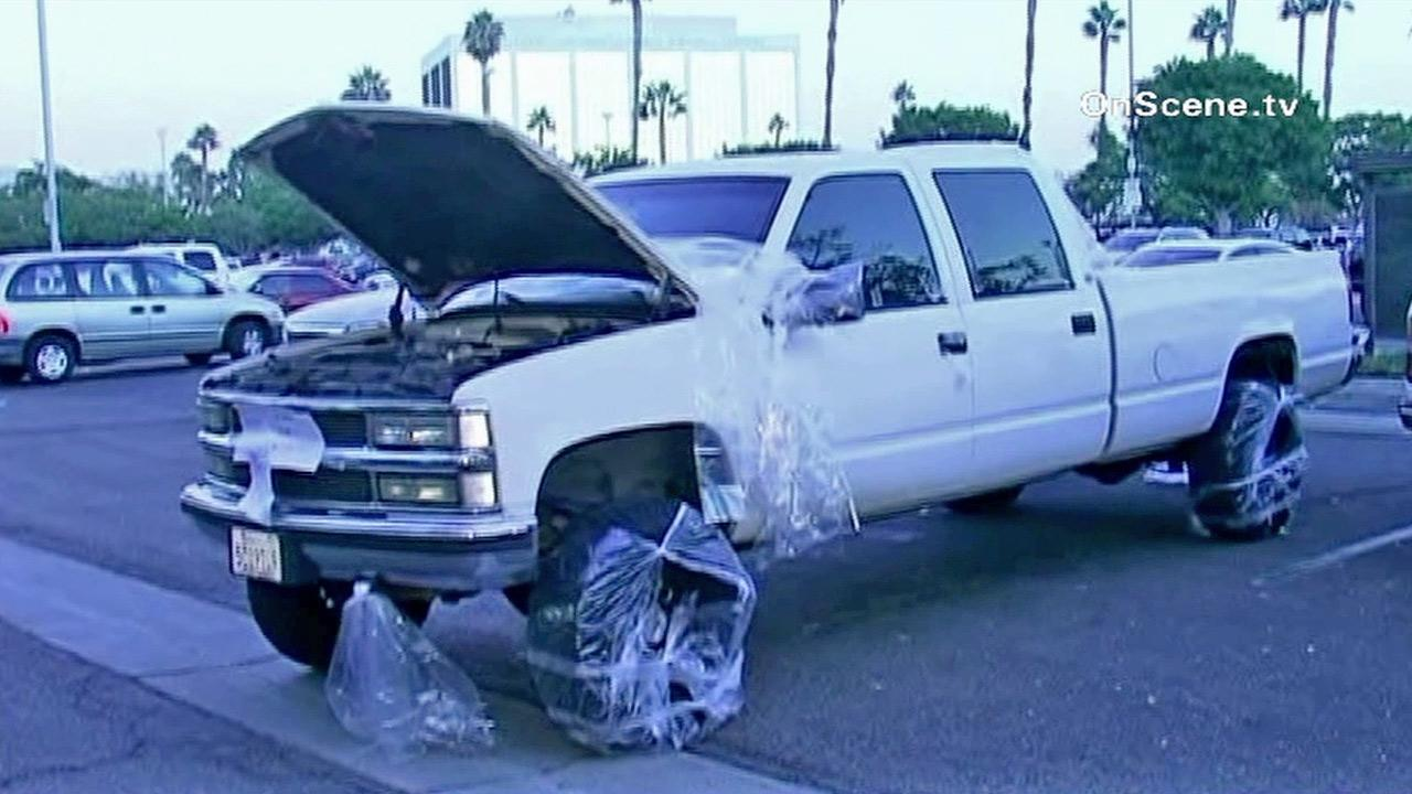 A car at the center of a hazmat hoax is shown in the Anaheim Memorial Medical Center parking lot on Thursday, Oct. 4, 2012.