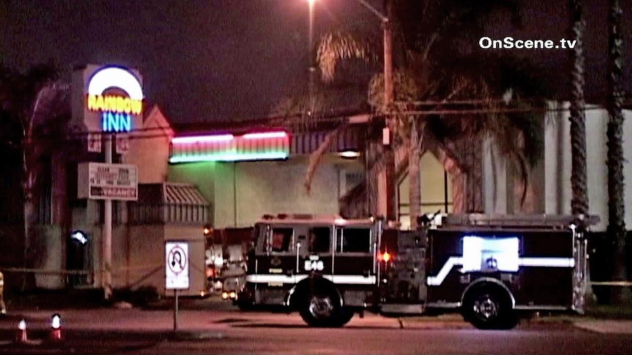 Authorities are seen at the Rainbow Inn in Anaheim where an explosion occurred Sunday, Oct. 7, 2012.