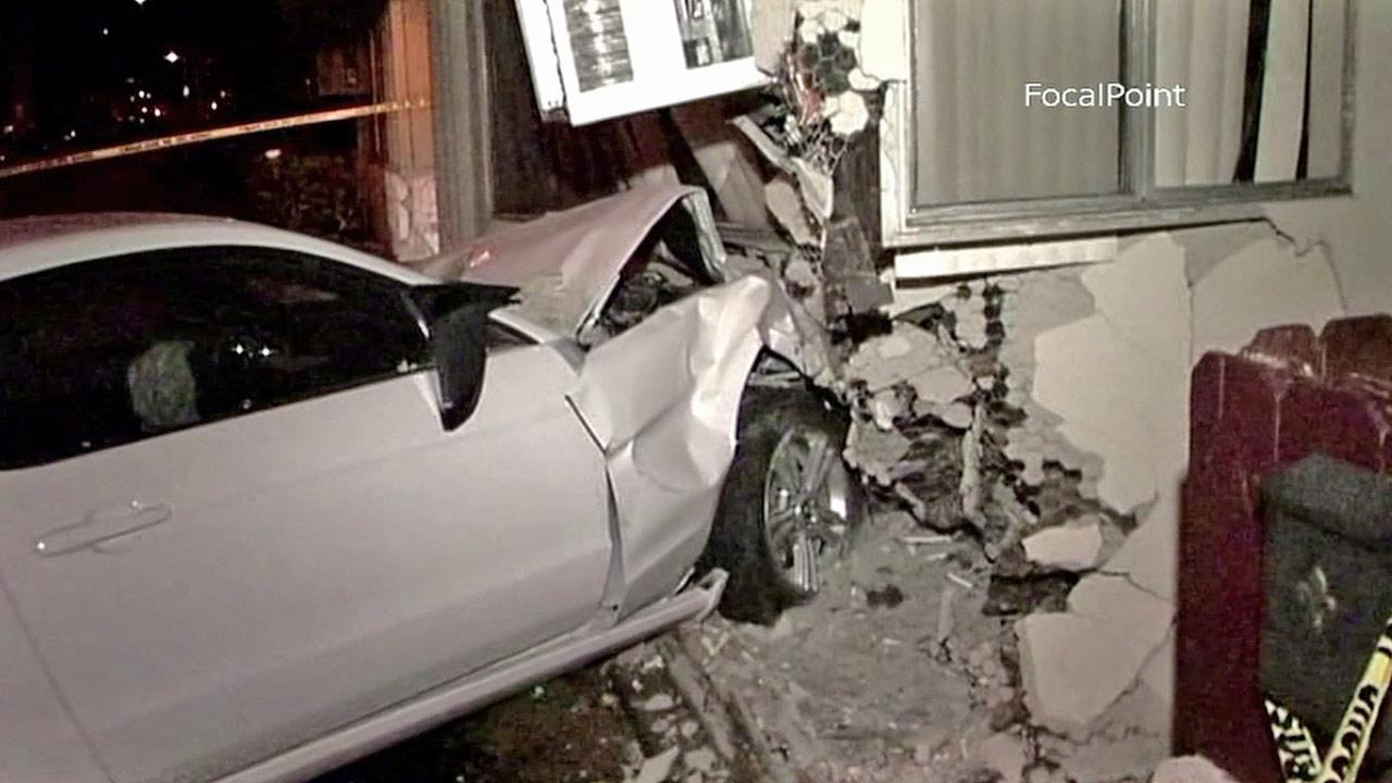 A car is shown after it rammed into an apartment building in Anaheim on Saturday, Oct. 27, 2012.