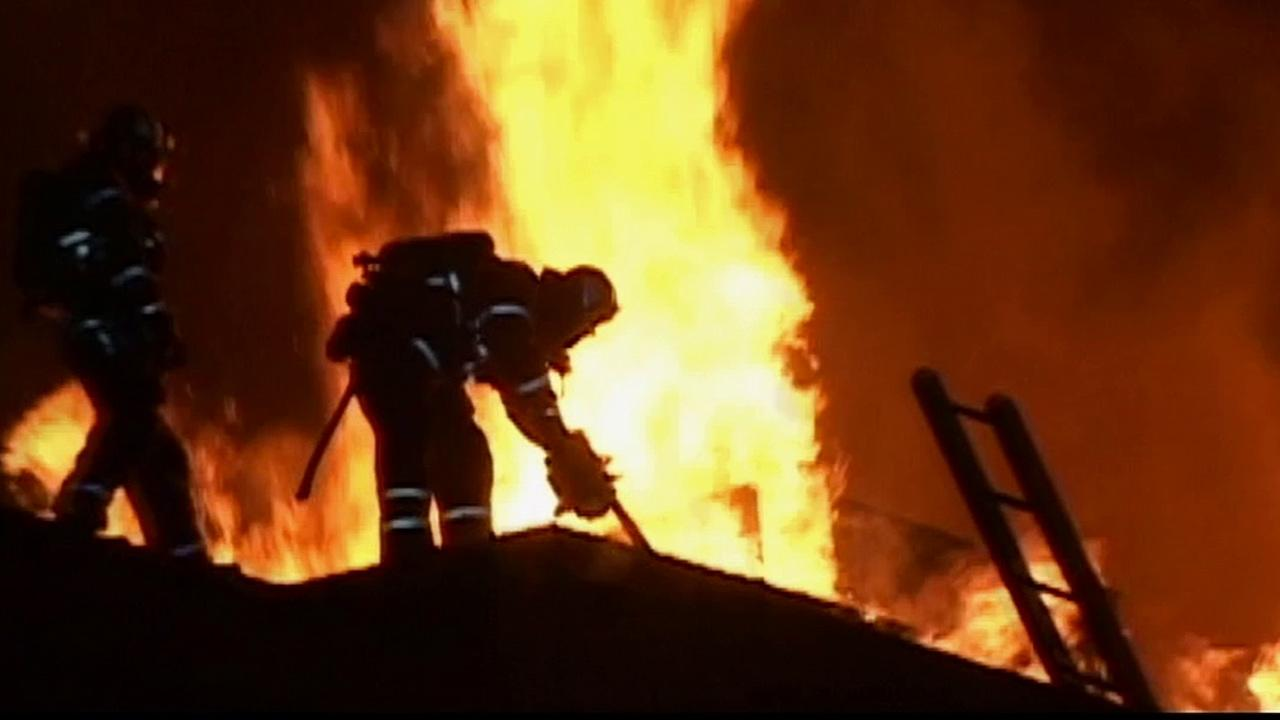 Firefighters battle a fire at an apartment complex in Fullerton on Sunday, Jan. 20, 2013.