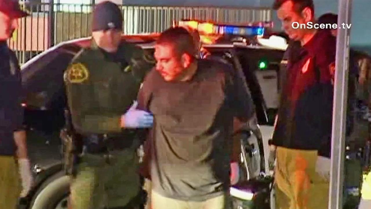 A suspect is taken into custody after leading Orange County deputies on a chase through the streets of Anaheim on Saturday, Feb. 23, 2013.