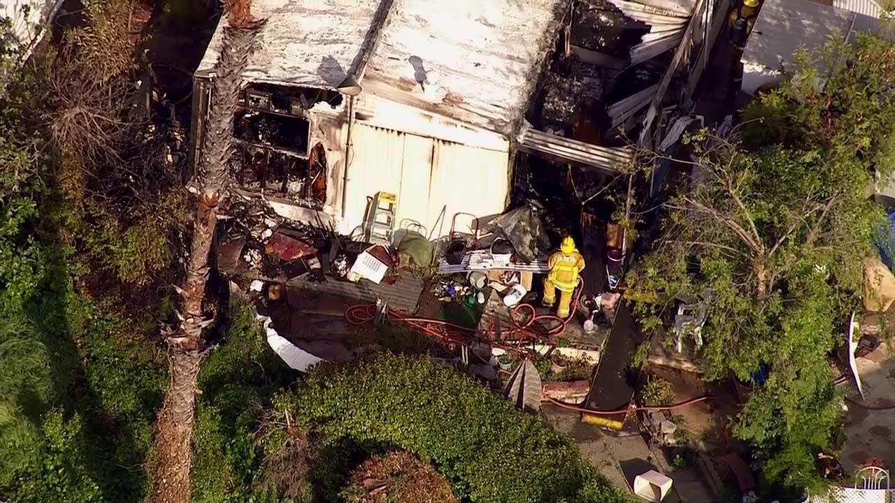 Authorities search a mobile home destroyed by a fire in La Habra on Monday, April 1, 2013.