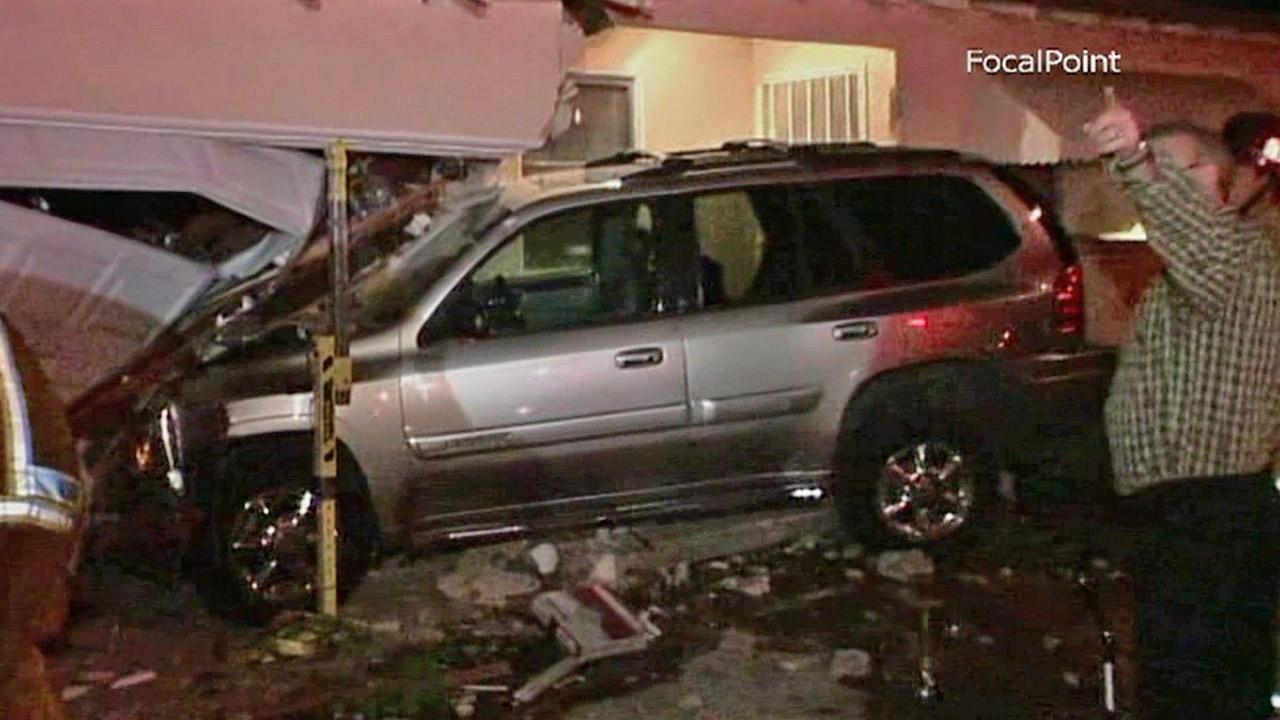 An SUV, seen above, slammed into a house in the 12000 block of Yorba Street near Tustin on Friday, April 26, 2013.