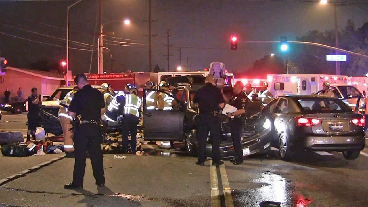 Law enforcement officials investigate the scene of a crash involving an allegedly drunk driver at Gilbert Street and La Palma Avenue in Anaheim on Sunday, May 12, 2013.