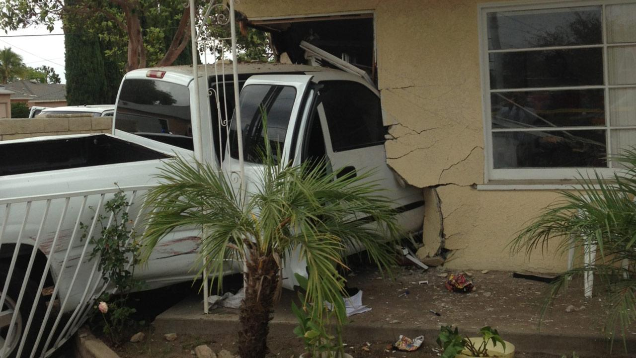 A police chase of a suspected stolen truck out of Westminster ended with a crash into a Santa Ana home Tuesday, May 28, 2013.