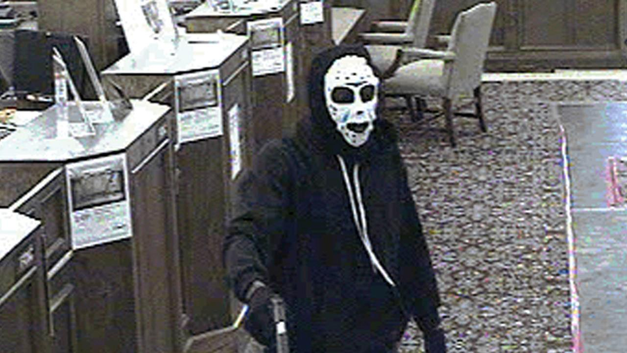 A surveillance photo shows a masked suspect wanted for an armed robbery at the U.S. Bank branch in the 2700 block of North Grand Avenue in Santa Ana on Tuesday, June 4, 2013.