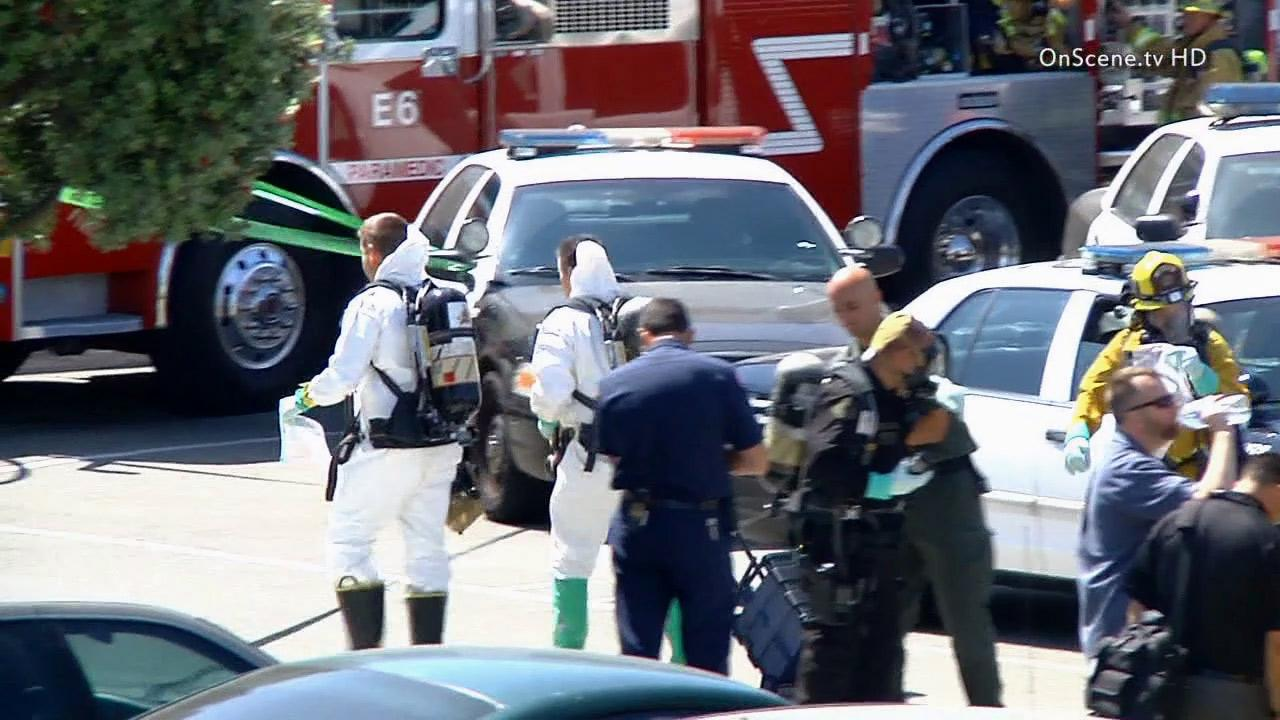 Police and a hazmat team investigate a letter with a suspicious substance found by a citizen Sunday, June 9, 2013.