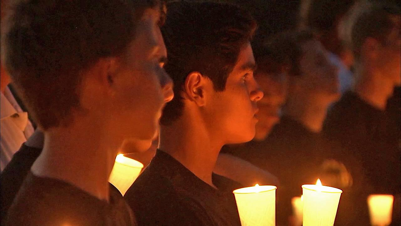 Students are seen at a vigil held for Mitchell Cook on Saturday, Aug. 10, 2013. Cook, 14, died during football practice at Canyon High School.