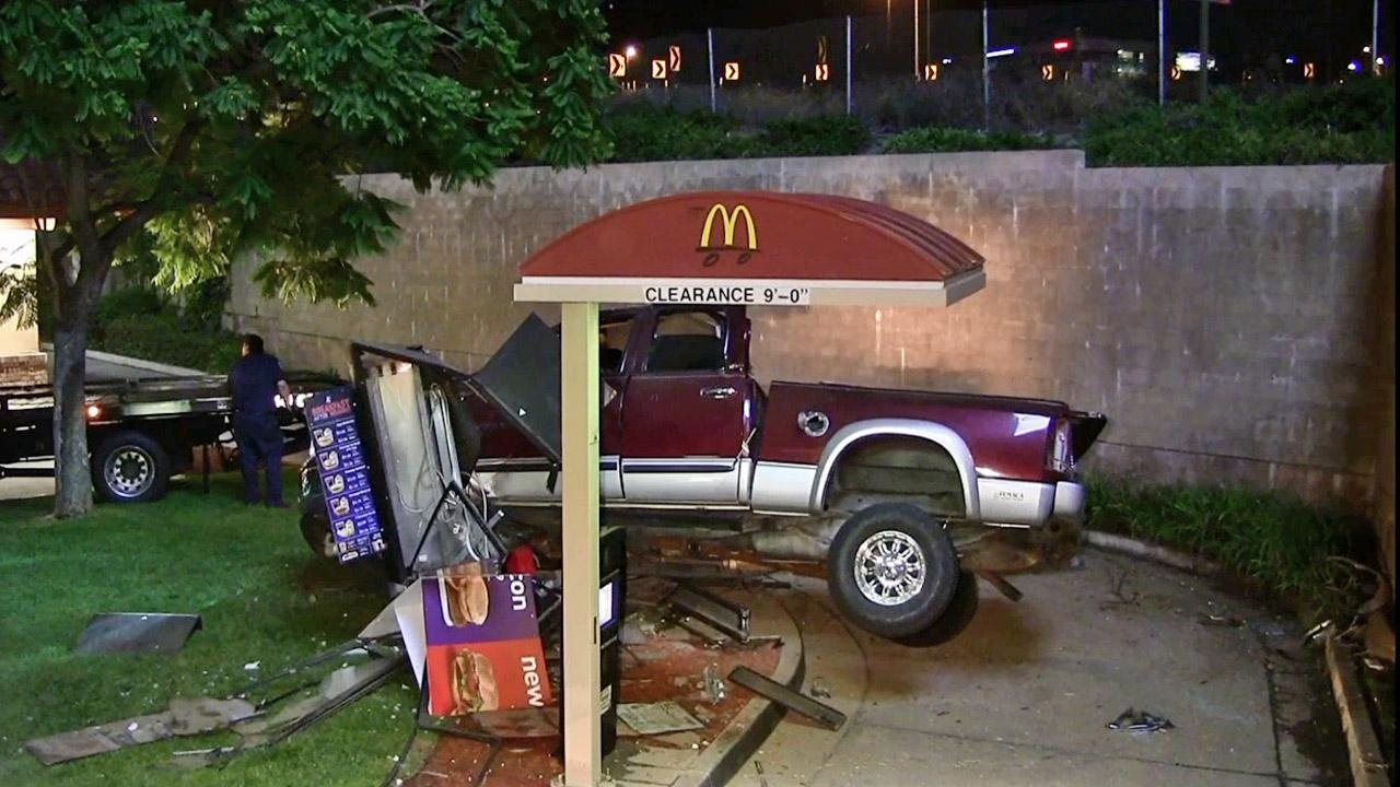 A pickup truck is seen after it crashed into the drive-thru of the McDonalds restaurant on the 22300 block of Old Canal Road in Yorba Linda on Saturday, Aug. 24, 2013.