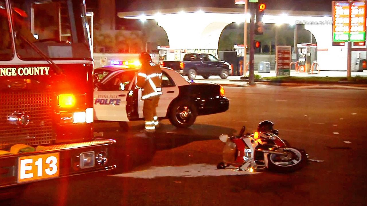 Police and fire officials are shown at the scene of a hit-and-run crash at Orangethorpe and Knott avenues in Buena Park on Tuesday, Sept. 3, 2013.