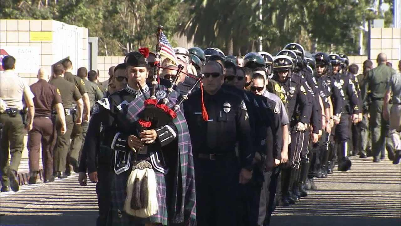 Friends and family of fallen Laguna Beach motorcycle officer Jon Coutchie gathered to honor the 42-year-old Tuesday, Sept. 24, 2013.