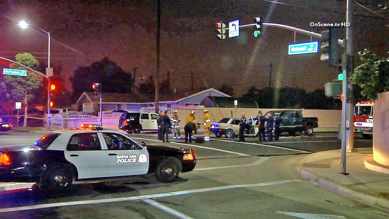 Police respond to the scene of a wrong-way crash at the intersection of McFadden Avenue and South Mohawk Drive in Santa Ana on Saturday, Nov. 16, 2013.