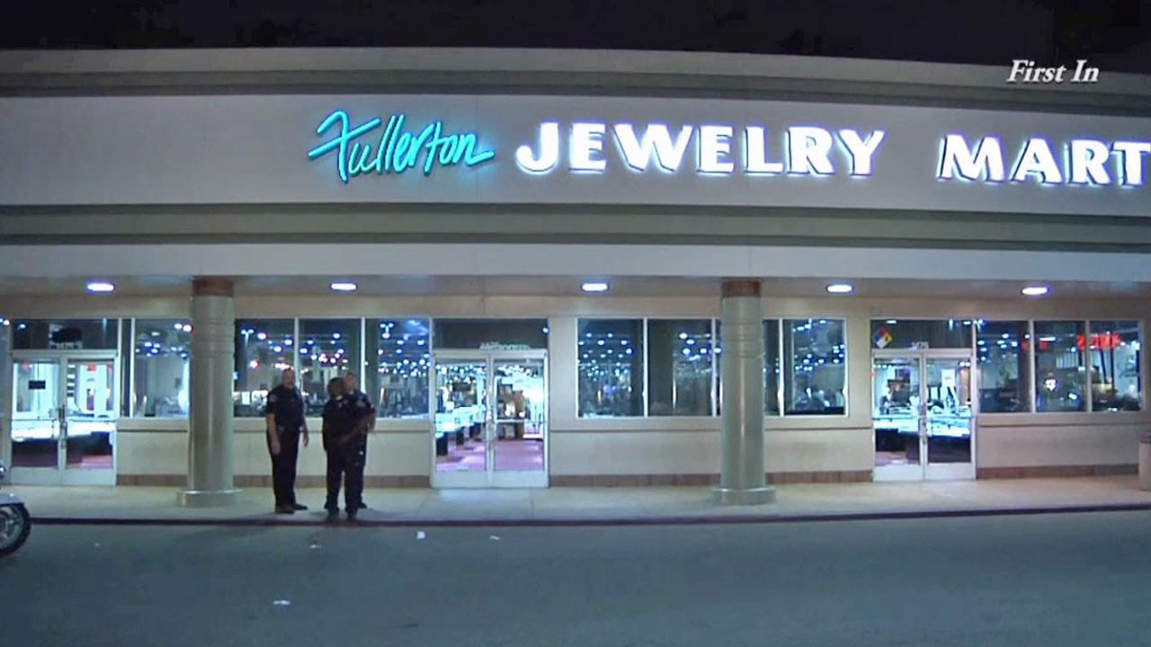 Police investigate an attempted robbery at the Fullerton Jewelry Mart on Wednesday, Nov. 20, 2013.