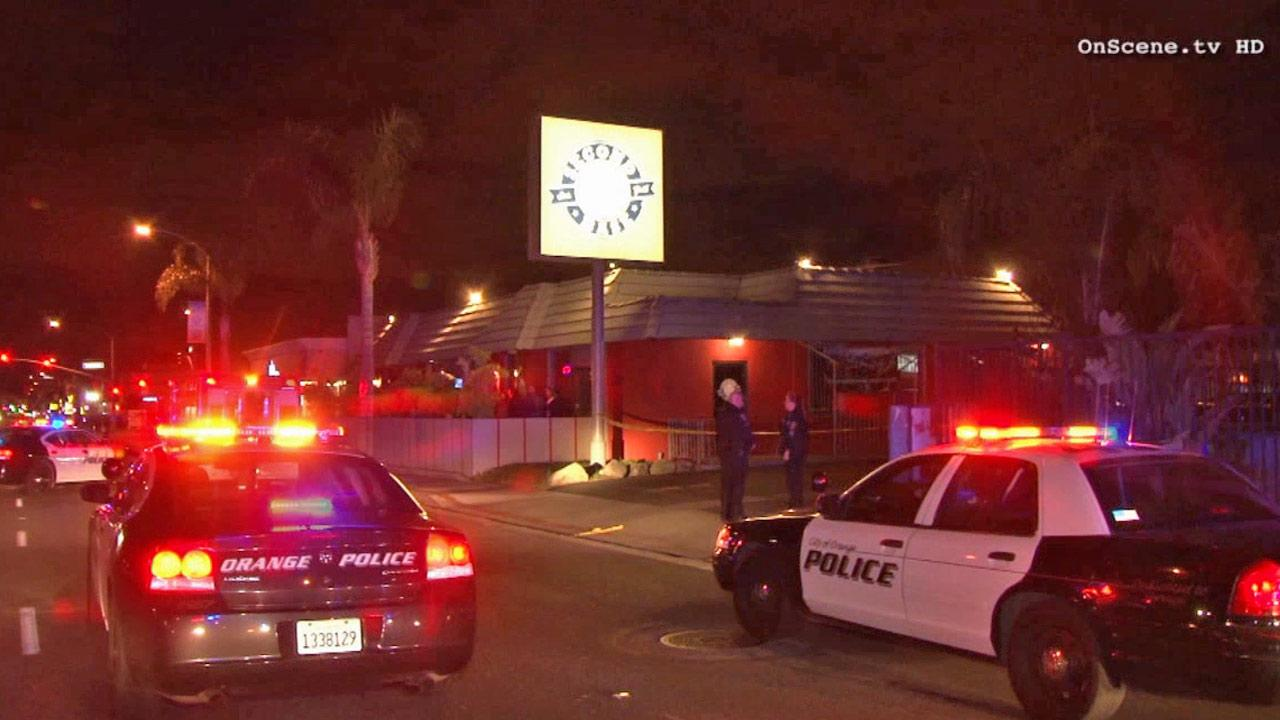 Police cruisers are shown at the scene of a fatal shooting outside a bar in the city of Orange on Friday, Nov. 22, 2013.