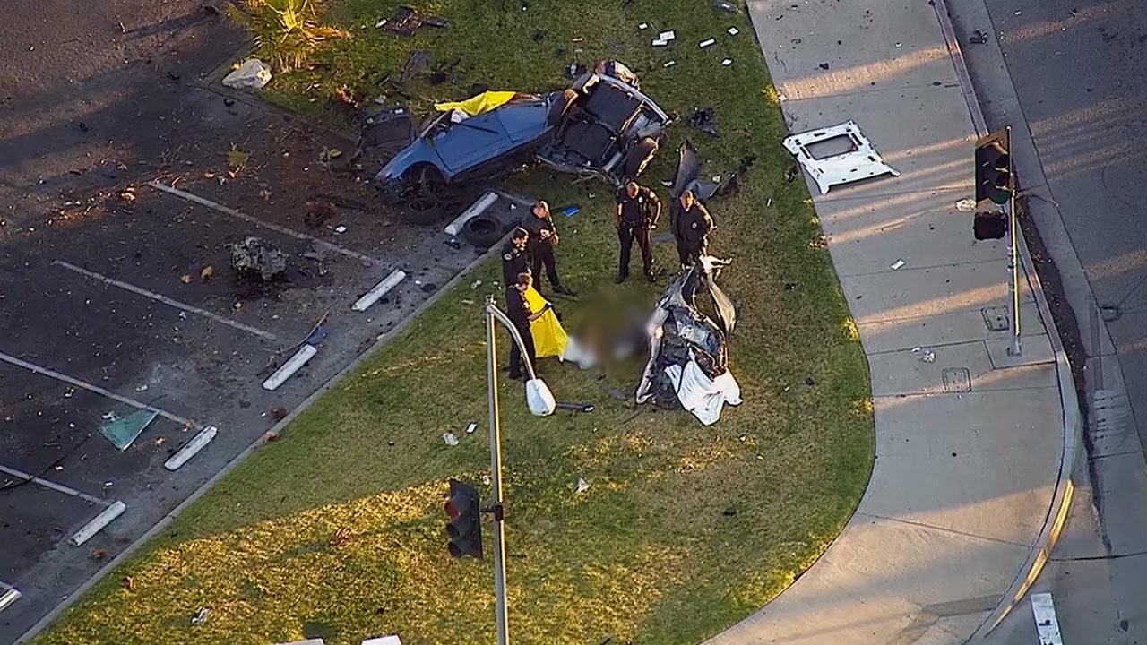 Two people were killed when their vehicle lost control and slammed into a tree in Huntington Beach Monday, Dec. 16, 2013.