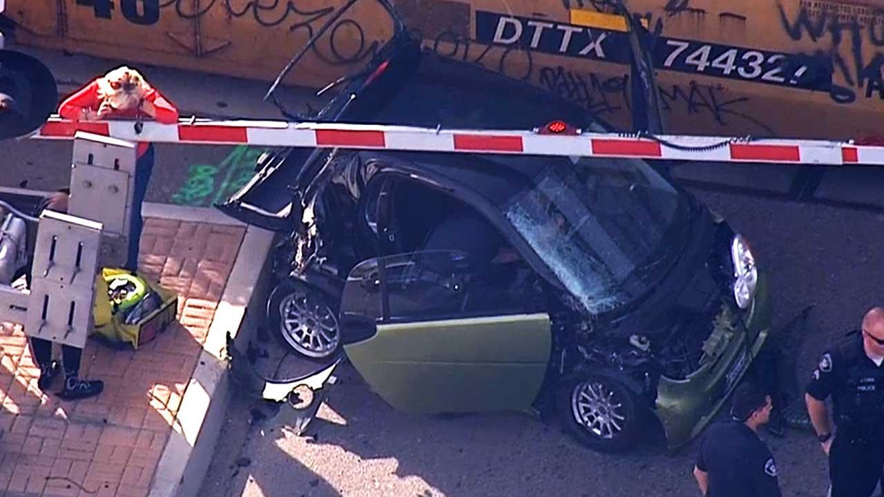 A train collided with a smart car near the border of Anaheim and Placentia in Orange County on Jan. 28, 2014.