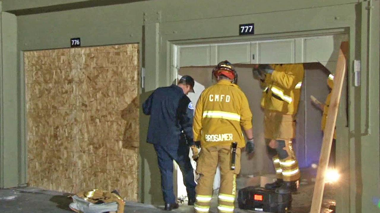 Costa Mesa fire officials inspect the scene of a garage fire near the 2700 block of Mesa Verde Drive East on Monday, Feb. 3, 2014.