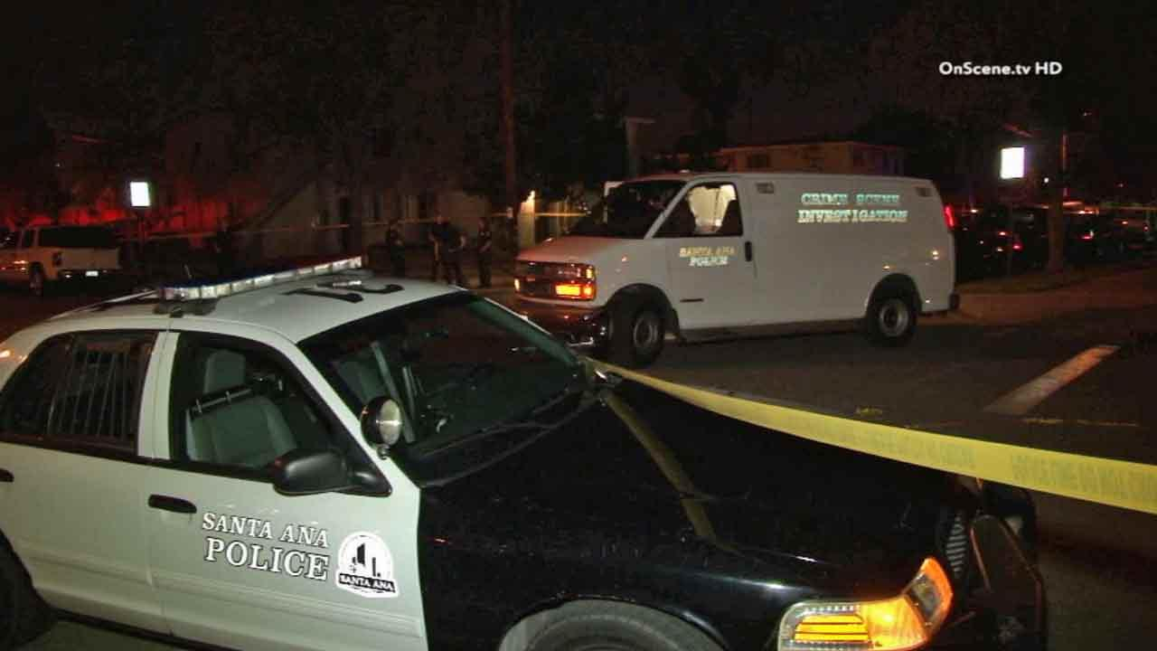 Santa Ana police respond to the scene of a shooting in the 1100 block of West Hemlock Way Monday, April 7, 2014.