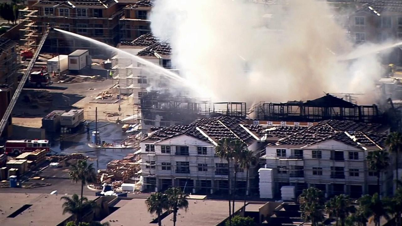 Fire crews battle a three-alarm blaze at a construction site in Anaheim on Tuesday, April 8, 2014.