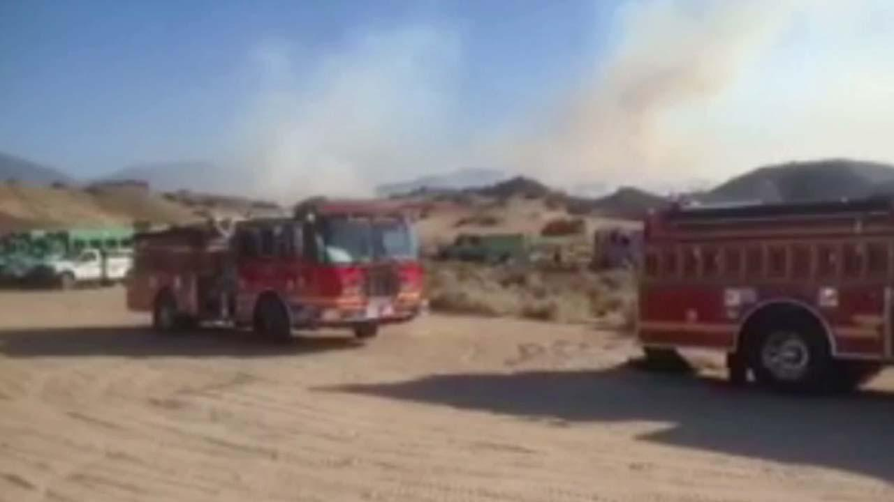 Firefighters were battling a brush fire near Hungry Valley and Gold Hill roads southwest of Gorman in Los Padres National Forest.