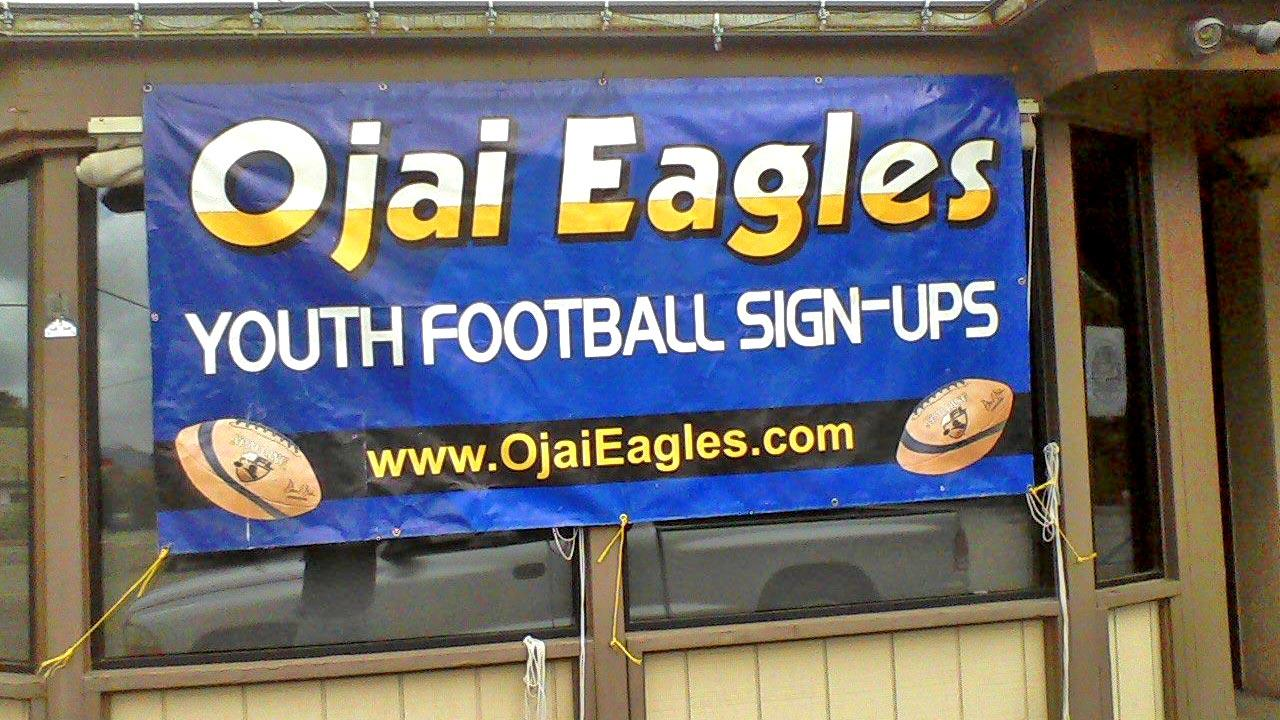A sig-up banner for the Ojai Eagle Youth Football Organization.