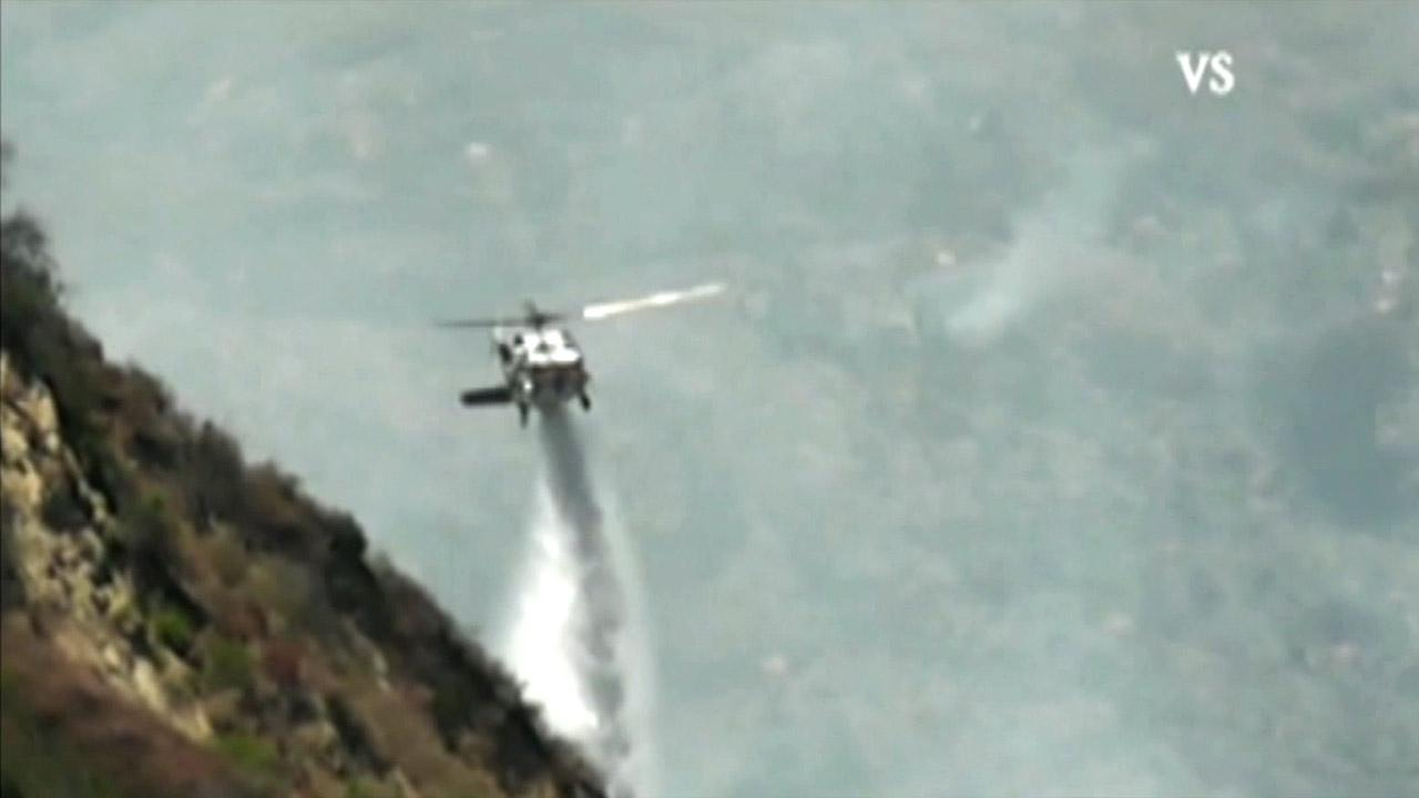 A helicopter makes a water drop over a fire in Los Padres National Forest on Sunday, Aug. 5, 2012.