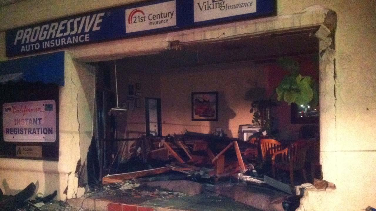 Damage is seen at Progressive Auto Insurance on Thompson Boulevard after a suspected driver slammed into the building on Monday, Aug. 27, 2012.