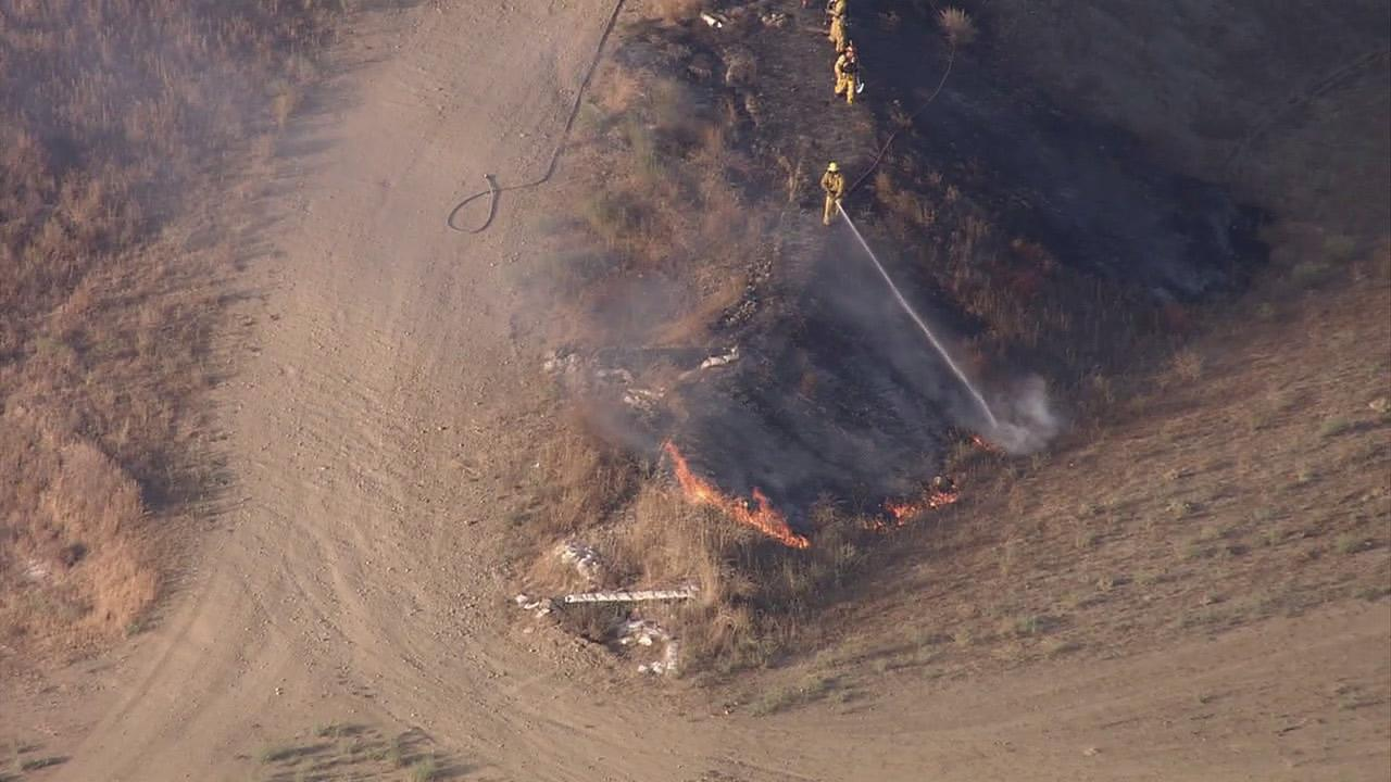 Fire crews are seen battling a brush fire in Simi Valley on Thursday, Aug. 30, 2012.