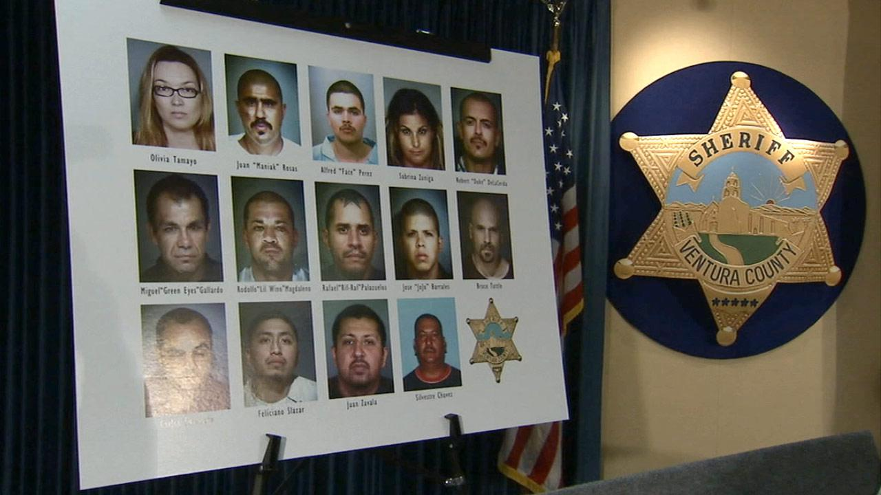 Ventura County Sheriffs Department officials put on display the faces of men and women arrested in a Mexican Mafia gang extortion case on Tuesday, Nov. 27, 2012.