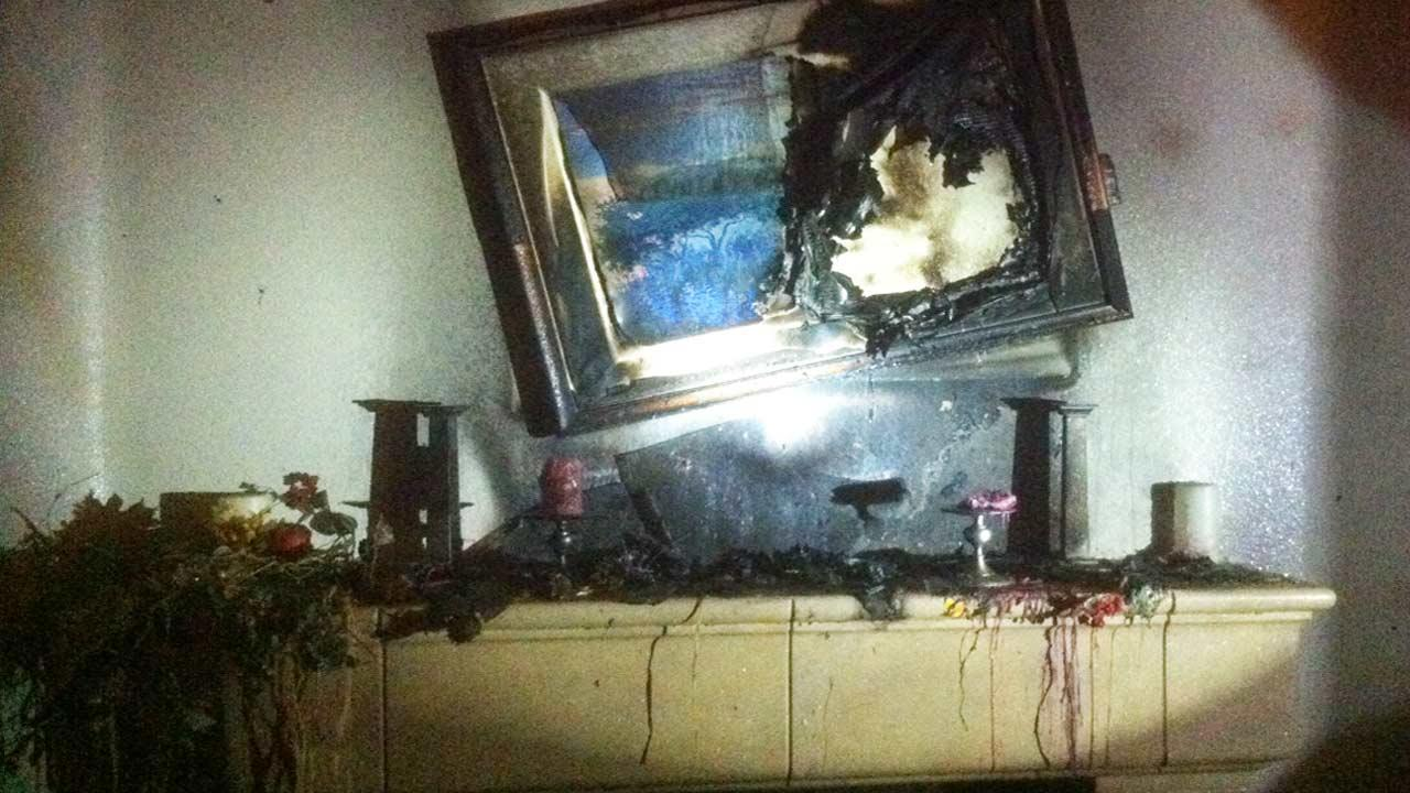 A fire tore through a structure on the 9600 block of Tule Lake Street in Ventura on Wednesday Nov. 28, 2012. Firefighters say unattended candles left on a fireplace mantel are to blame.
