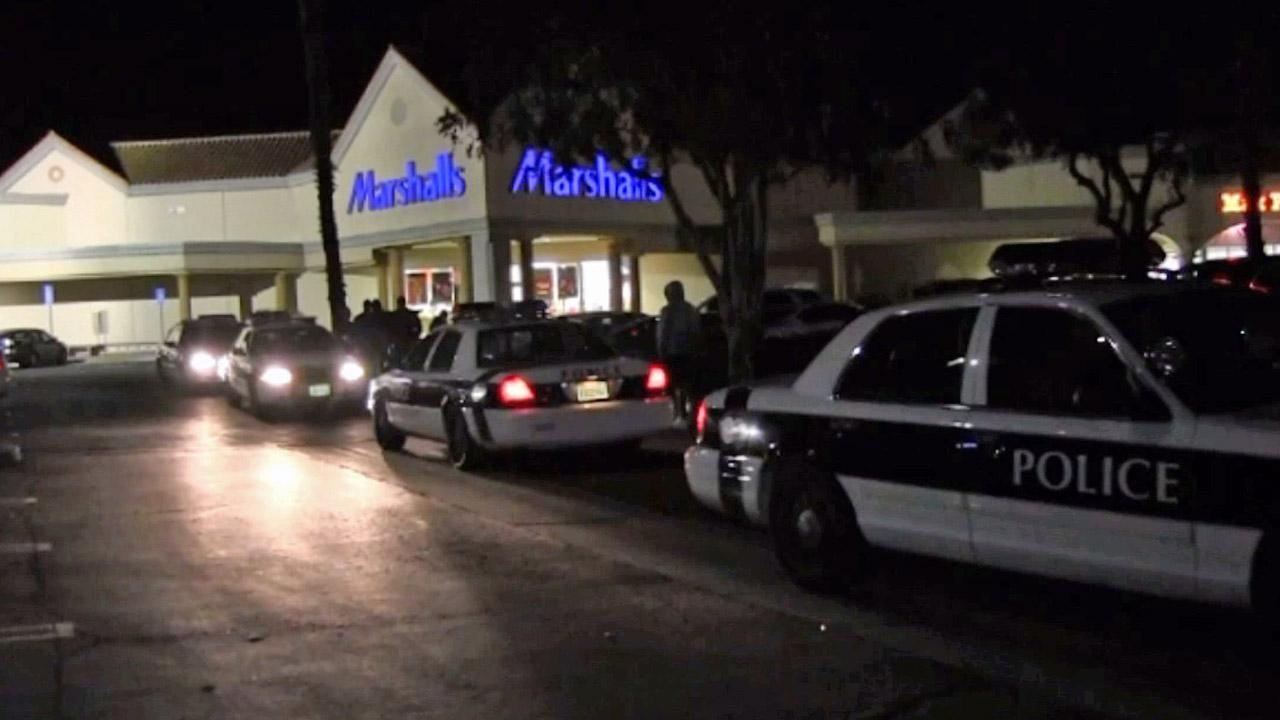 Police patrol cars line up outside a Marshalls in Oxnard on Ventura Boulevard after a woman was attacked in an attempted carjacking on Thursday, Dec. 20, 2012.
