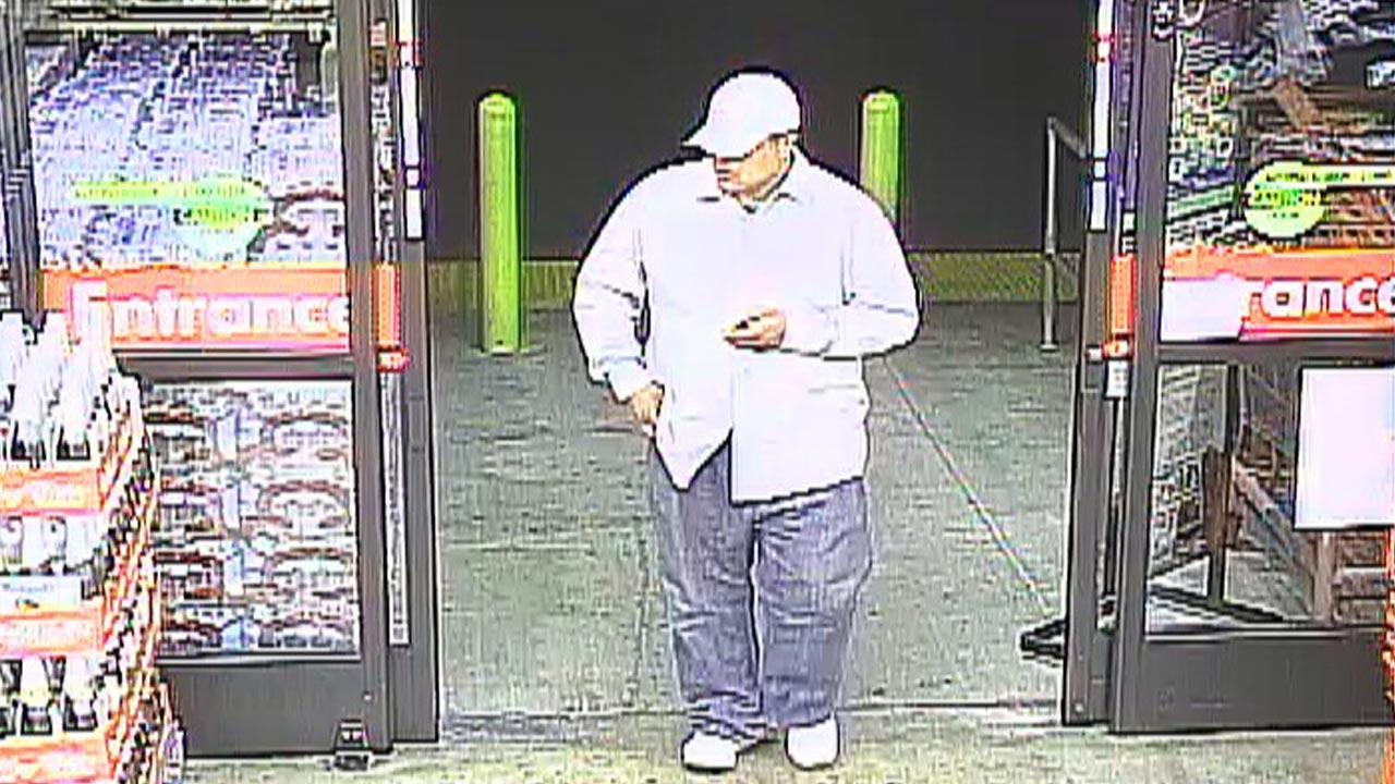 An armed robbery suspect was described as a clean-shaven Hispanic male about 35 years old, standing about 5 feet 11 inches tall, weighing about 275 pounds.
