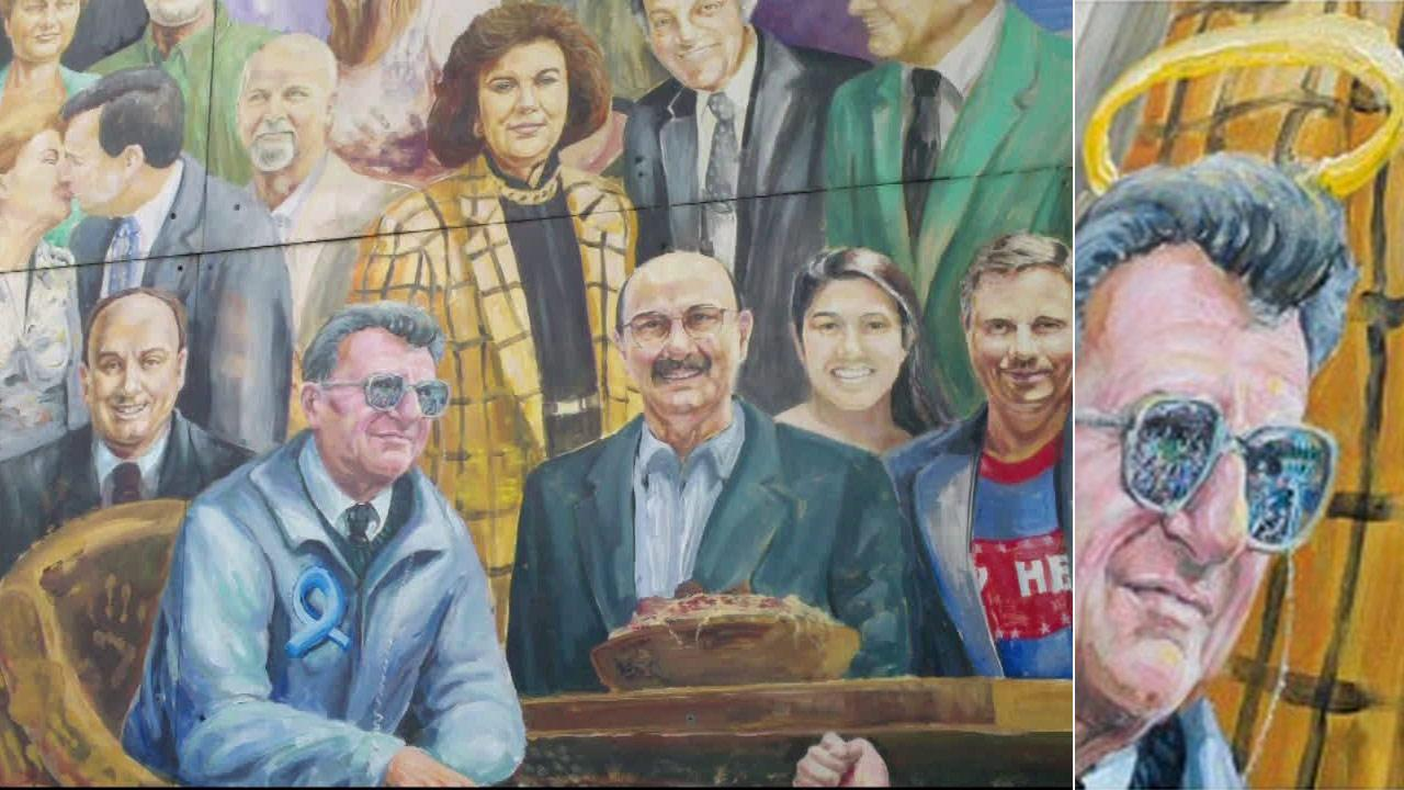 Artist Michael Pilato painted over a halo he placed over Penn State football coach Joe Paternos head in a mural. He added a blue ribbon to the coachs jacket, symbolizing support for child-abuse victims.