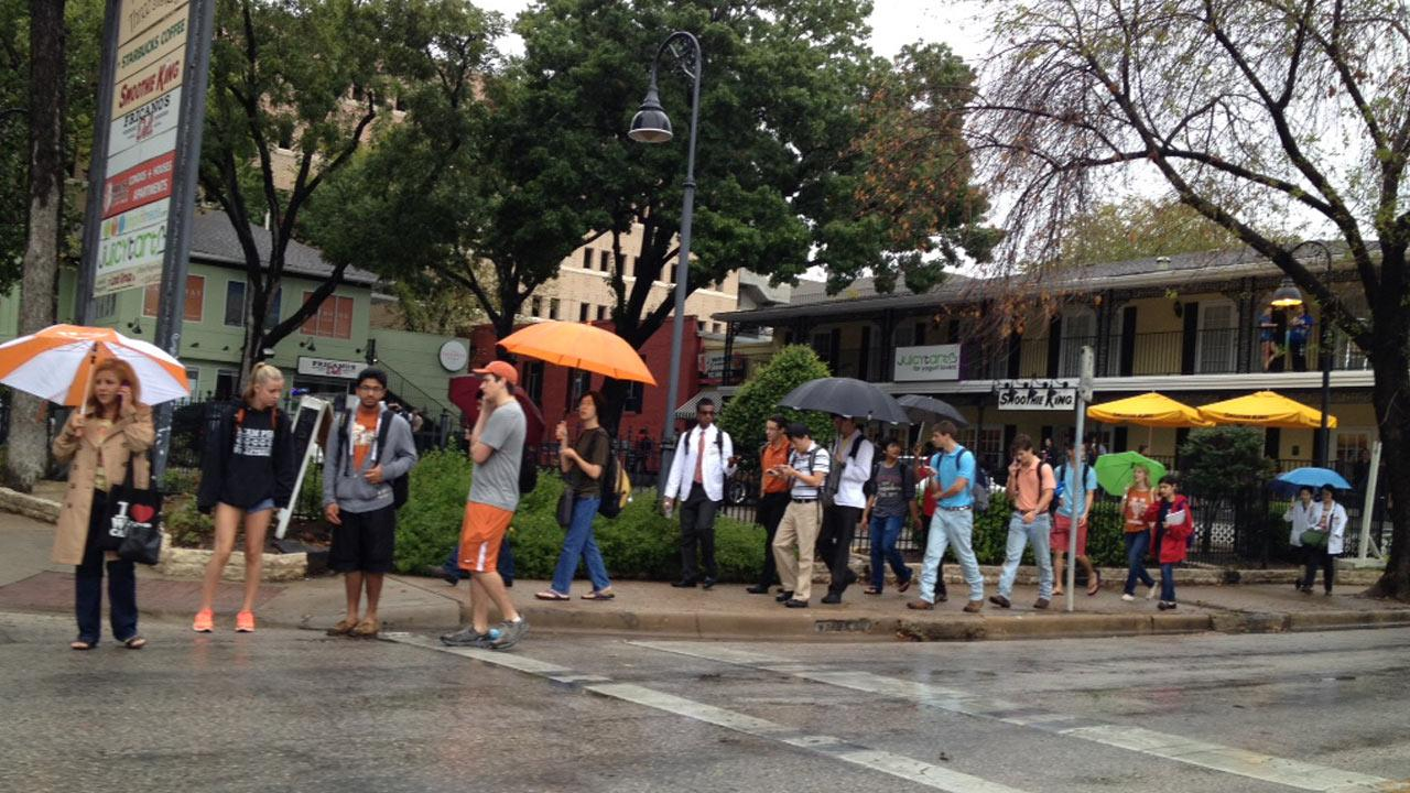 University of Texas students are shown after a campus evacuation was ordered following a bomb threat on Friday, Sept. 14, 2012.