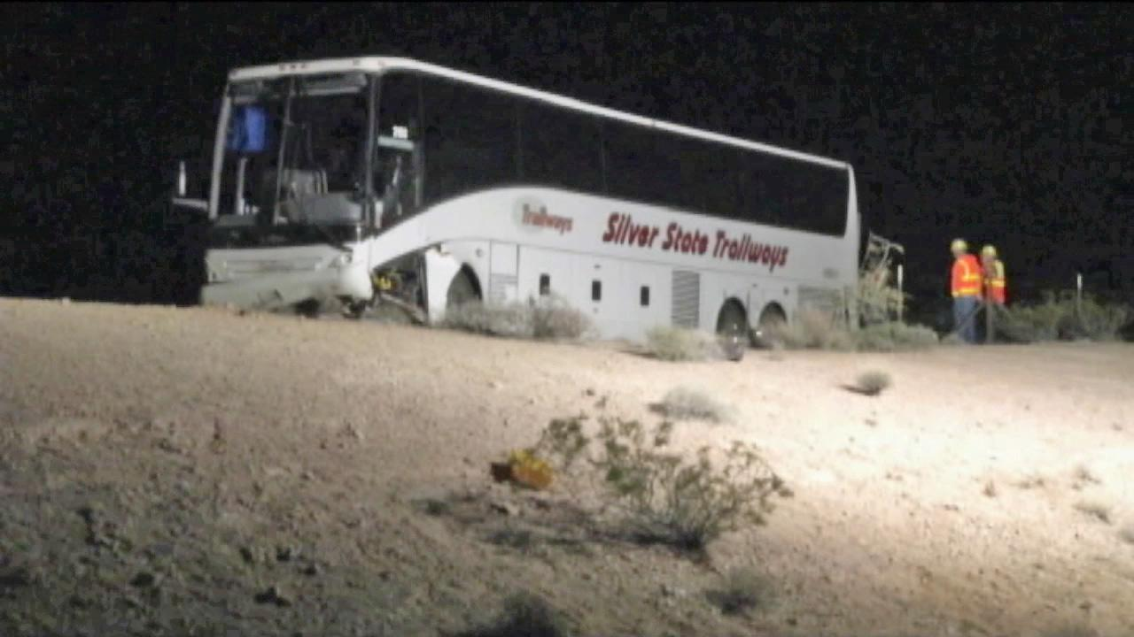 A bus is seen after it crashed in Willow Beach, Ariz., on Friday, Oct. 19, 2012, killing the driver and injuring all passengers on board.
