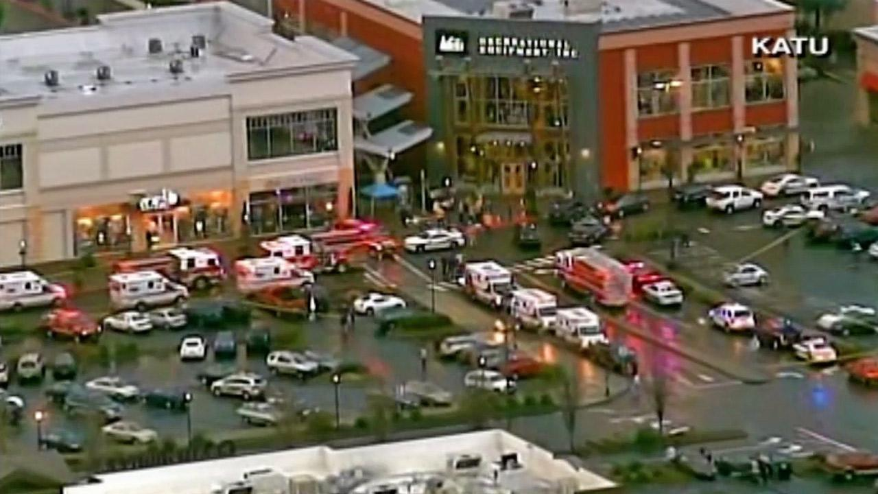 Emergency vehicles respond to a shooting at Clackamas Town Center near Portland, Ore., on Tuesday, Dec. 11, 2012.