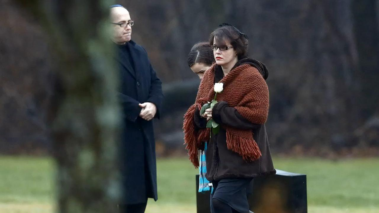 The mother of 6-year-old Noah Pozner held a single white rose as she arrived to his funeral on Monday, Dec. 17, 2012. The boy was among 26 victims of a shooting rampage at an elementary school in Newtown, Conn.