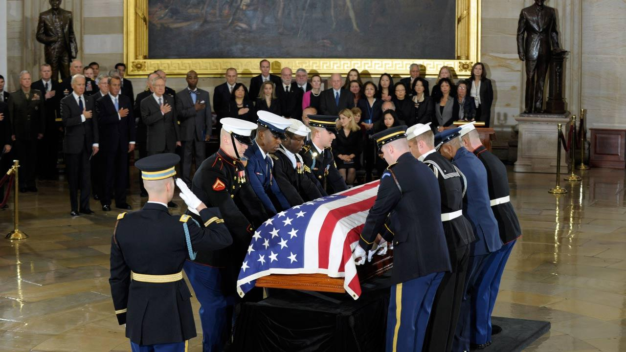 A joint military honor guard carries in the casket of Sen. Daniel Inouye, D-Hawaii, the second-longest-serving senator in history, to lie in state in the Capitol Rotunda in Washington, Thursday, Dec. 20, 2012.