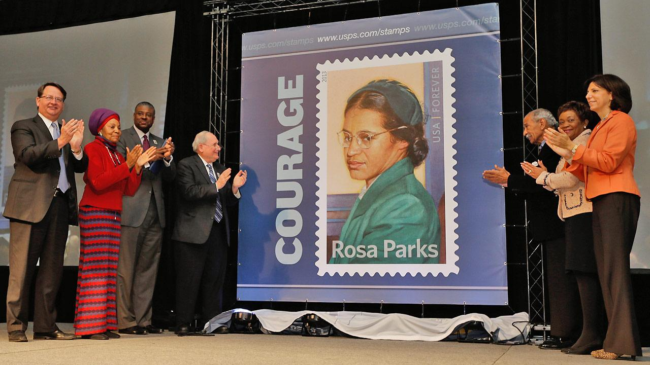 The Rosa Parks 100th birthday commemorative postage stamp is unveiled at The Henry Ford in Dearborn, Mich., Monday, Feb. 4, 2013.
